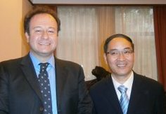 Augusto Soto with Shao Huixiang, Deputy Director General of the Shanghai Municipal Foreign Affairs Office, Shanghai, June 2012
